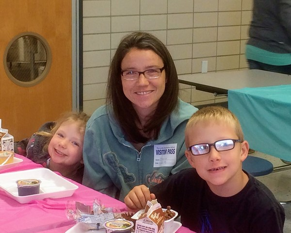 Former PES student visits with her children